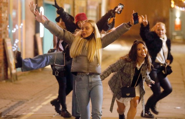 A group of girls hit the town in York, United Kingdom on December 30, 2020. Revellers hit the streets for a final drink before being plunged into Tier 4 lockdown. (Photo by Nb press ltd)