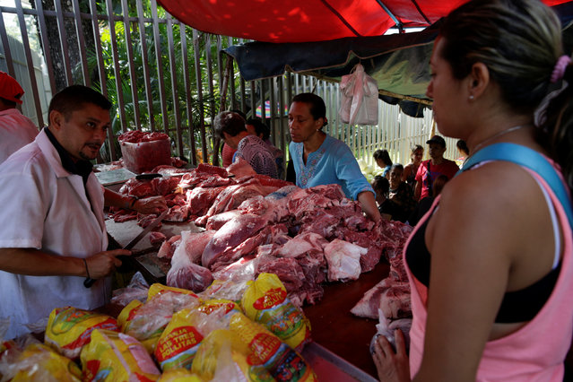 People buy meat at a market in Caracas, Venezuela October 28, 2016. (Photo by Marco Bello/Reuters)