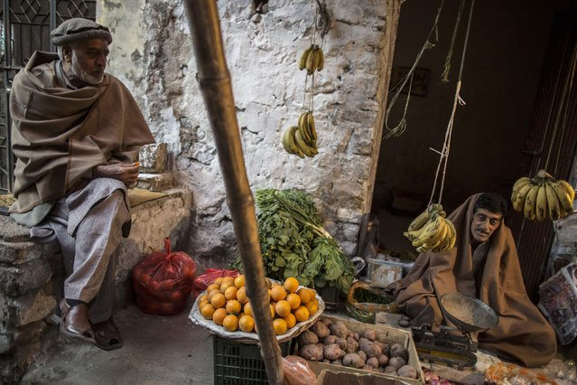 A street vegetable seller waits for customers in Islamabad January 6, 2015. (Photo by Zohra Bensemra/Reuters)