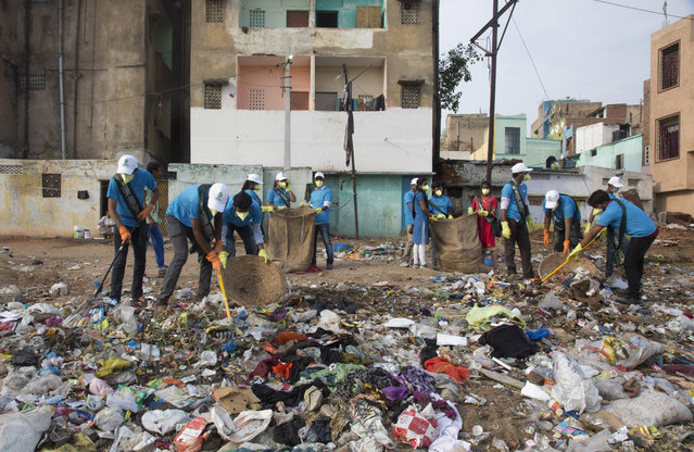 "Members of National Green Corps clean up plastic garbage along the Musi river in Hyderabad, India, Sunday, June 3, 2018. India is the global host for the forthcoming environmental day celebrations on june 5, 2018 with a theme ""Beat Plastic Pollution"" and launched an awareness program on environmental protection. (Photo by Mahesh Kumar A./AP Photo)"