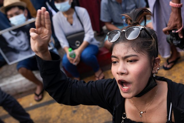 A demonstrator takes part in a protest against the military coup in Yangon, Myanmar, February 17, 2021. (Photo by Reuters/Stringer)