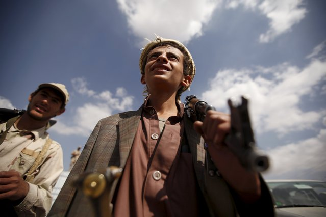 A tribesman loyal to the Houthi movement carries his rifle as he leaves a gathering held to show support for the group, in Yemen's capital Sanaa December 15, 2015. (Photo by Khaled Abdullah/Reuters)