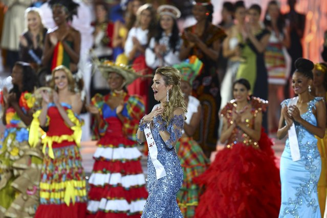 Newly crowned Miss World Mireia Lalaguna Royo from Spain, center reacts as she is announced the winner of the 2015 Miss World Grand Final in Sanya in south China's Hainan province Saturday December 19, 2015. (Photo by Chinatopix Via AP Photo)