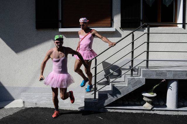 Spectators dressed in dancing tutu rush to watch the riders during the tenth stage of the 105th edition of the Tour de France cycling race between Annecy and Le Grand-Bornand, French Alps, on July 17, 2018. (Photo by Philippe Lopez/AFP Photo)