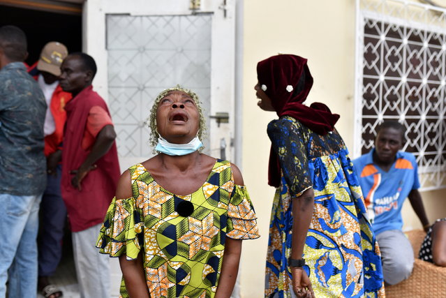 Women cry after Congo Republic's opposition presidential candidate Guy Brice Parfait Kolelas died from coronavirus disease (COVID-19) at the Union of Humanist Democrats offices in Brazzaville, Republic of Congo, March 22, 2021. (Photo by Olivia Acland/Reuters)