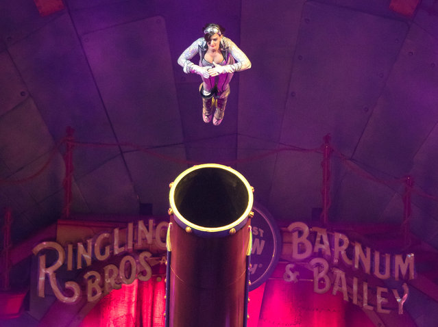 This image released by Feld Entertainment shows Gemma Kirby, the 25-year-old human cannonball during a performance at Circus Xtreme where she hurtles out of a cannon at up to 66 mph and lands up to 104 feet away in an air bag. Kirby will be celebrating a special milestone on Saturday: She's expected to notch her 500th total flight in Philadelphia. (Photo by AP Photo/Feld Entertainment)