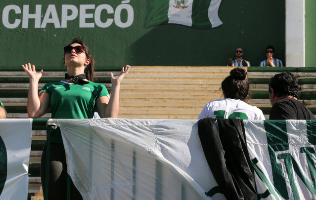 A fan of Chapecoense soccer team reacts at the Arena Conda stadium in Chapeco, Brazil, November 29, 2016. (Photo by Paulo Whitaker/Reuters)