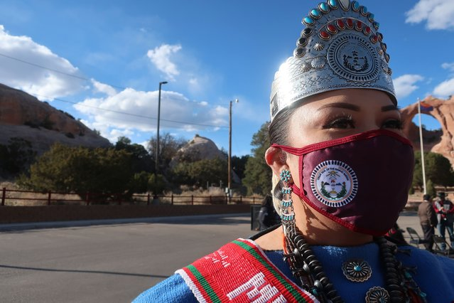 Miss Navajo Shaandiin Parrish awaits the arrival of First Lady Jill Biden at a Navajo Nation tribal park in Window Rock, Ariz., on Thursday, April 22, 2021. The trip is Biden's third to the vast reservation that stretches into Arizona, New Mexico and Utah. (Photo by Felicia Fonseca/AP Photo)