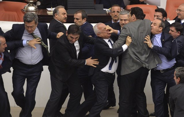 Lawmakers from the main opposition Republican People's Party (CHP) and ruling AK Party (R) scuffle during a debate on a legislation to boost police powers, at the Turkish Parliament in Ankara late February 19, 2015. The legislation, which would bolster the powers of the authorities to control protests. (Photo by Reuters/Stringer)