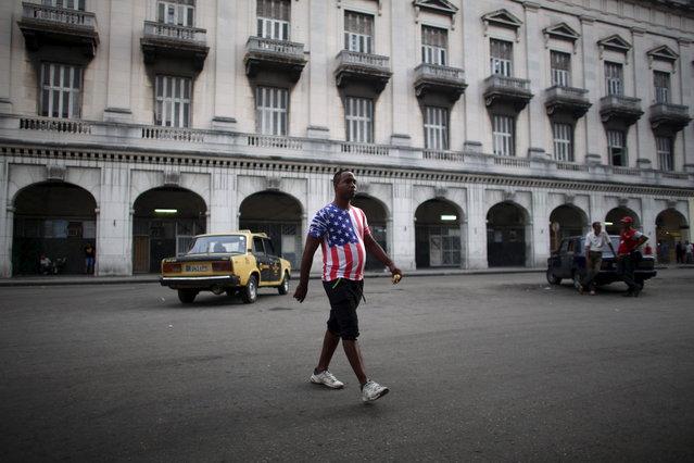 Street seller Orlando Hernandez, 38, walks in downtown Havana, July 21, 2015. (Photo by Alexandre Meneghini/Reuters)