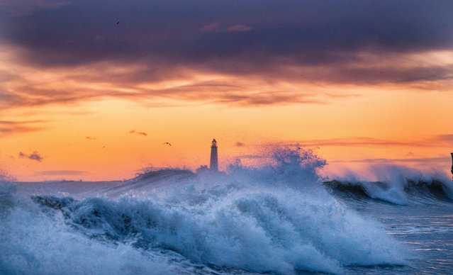 Waves crash onto rocks near to St Mary's Lighthouse in Whitley Bay on the North East Coast, England on February 25, 2020. (Photo by Owen Humphreys/PA Images via Getty Images)
