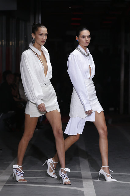 Models Bella Hadid, left, and Kendall Jenner wear creations for the Off White Spring/Summer 2019 ready to wear fashion collection presented in Paris, Thursday, September 27, 2018. (Photo by Thibault Camus/AP Photo)