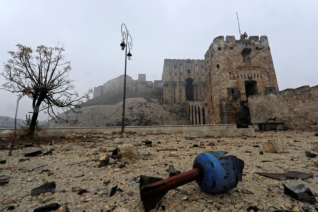 The remains of a shell are pictured outside Aleppo's historic citadel, during a media tour, Syria December 13, 2016. (Photo by Omar Sanadiki/Reuters)