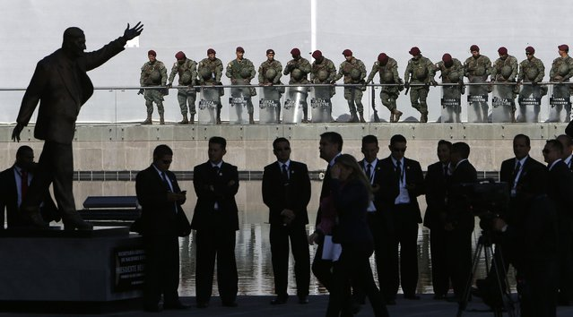 Security personnel guard the Unasur building during the IV Summit of the Community of Latin American and Caribbean States, CELAC, in Quito, Ecuador, Wednesday, January 27, 2016. The Dominican Republic will take over the rotating presidency of the CELAC from Ecuador, during the summit. (Photo by Dolores Ochoa/AP Photo)