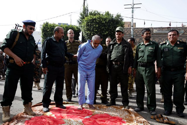 Ali al-Naami, convicted of murdering his three daughters, is placed on a carpet to be executed at a public square in Sana'a, Yemen, 16 June 2021. Defendant Ali al-Naami, 40, convicted of killing his daughters Rahaf, 7, Raghad, 12, and Malak, 14, in June 2019, was executed by an executioner in front of hundreds of spectators in a public square in Sana'a. He had admitted to strangling them and drowning them in a water tank after the mother left the house due to domestic disputes with him. (Photo by Yahya Arhab/EPA/EFE)