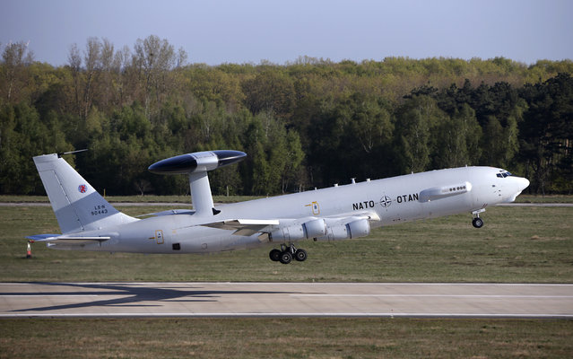 A NATO AWACS (Airborne Warning and Control Systems) aircraft is seen taking-off for a flight to Romania from the AWACS air base in Geilenkirchen, near the German-Dutch border in this April 16, 2014 file photo. The head of NATO said on January 28th, 2016 that the United States has requested the alliance's help in fighting Islamic State in the Middle East by providing surveillance planes called the Airborne Warning and Control System (AWACS). (Photo by Francois Lenoir/Reuters)