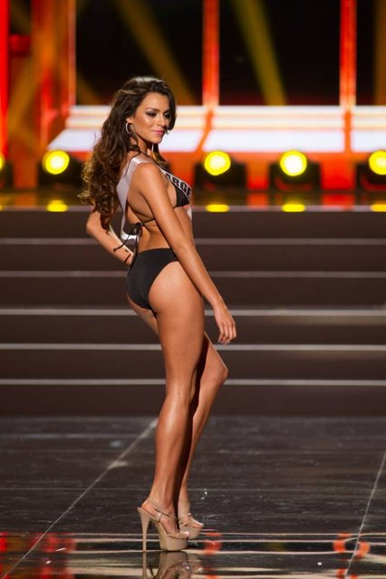 This photo provided by the Miss Universe Organization shows Brenda Gonzalez, Miss Argentina 2013, competes in the swimsuit competition during the Preliminary Competition at Crocus City Hall, Moscow, on November 5, 2013. (Photo by Darren Decker/AFP Photo)