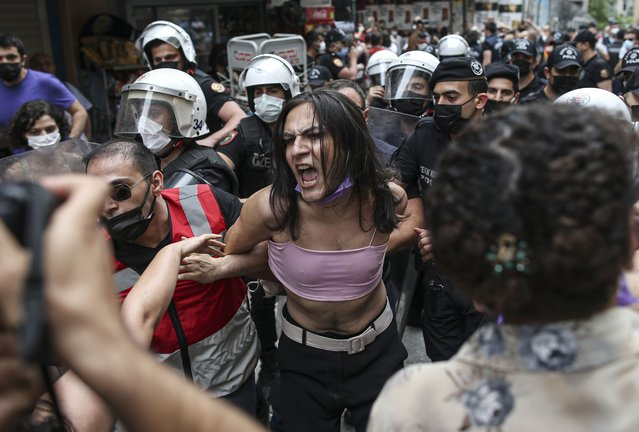 Protesters are detained by police in central Istanbul, Saturday, June 26, 2021. (Photo by Emrah Gurel/AP Photo)