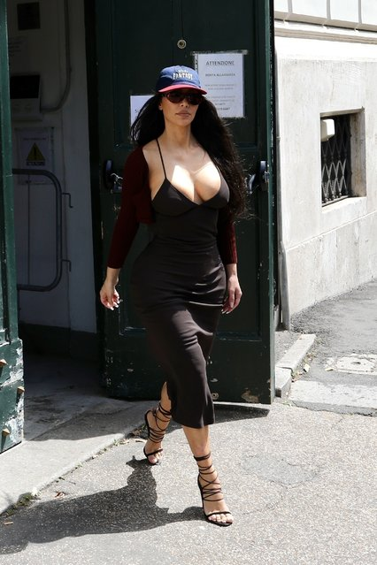 """Kim Kardashian meets with Fendi/Dior Artistic director Kim Jones at """"Palazzo della Città"""" in Eur area in Rome. The reality star wore a curve hugging low cut dress wi on June 29, 2021th stilettos and a cap. Kim was joined by her glam squad and assistant, Tracy. She was followed by a cameraman and stopped to pose in front of the building before meeting the designer who greeted her with kisses at the door. (Photo by Backgrid USA)"""