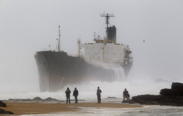 A ship which broke free from a tow line lies stranded near the shore at Sheffield Beach, north of Durban, South Africa, July 26, 2011. (Photo by Rogan Ward/Reuters)