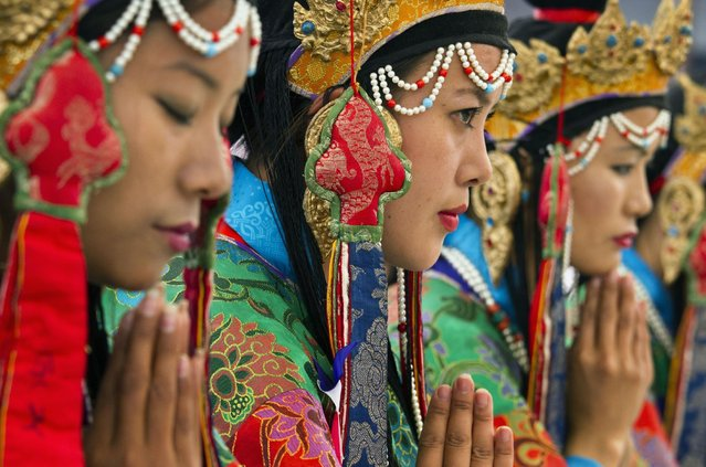 Tibetan artists in traditional costumes perform opera at the Tibetan Institute of Performing Arts in Dharmsala, India, Friday, March 27, 2015. (Photo by Ashwini Bhatia/AP Photo)