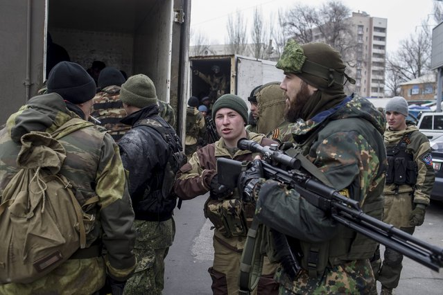 Pro-Russian rebels take their positions on a street, during what the rebels said was an anti-terrorist drill in Donetsk, March 18, 2015. (Photo by Marko Djurica/Reuters)