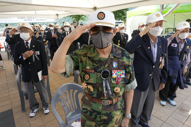 Korean War veterans salute during a ceremony to mark the 71th anniversary of the outbreak of the Korean War in Hwacheon, near the border with North Korea, South Korea, Friday, June 25, 2021. The three-year Korean War broke out on June 25, 1950, when Soviet tank-led North Koreans invaded South Korea. (Photo by Ahn Young-joon/AP Photo)
