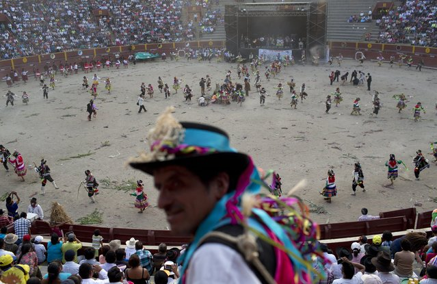 In this Sunday, March 29, 2015 photo, dancers from the Huanta district of Ayacucho, perform a traditional dance during the Vencedores de Ayacucho dance festival, in the Acho bullring in Lima, Peru. (Photo by Rodrigo Abd/AP Photo)