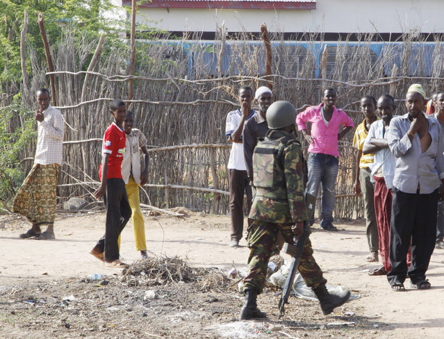 A member of Kenya's Defence Forces secures the area of the Garissa University college, in Garissa, Kenya, Thursday, April 2, 2015. (Photo by Khalil Senosi/AP Photo)