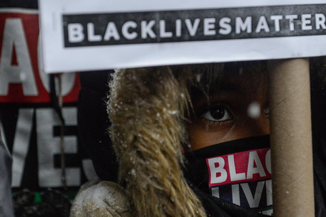 People participate in a Black Lives Matter protest in front of Trump Tower in New York City, U.S. January 14, 2017. (Photo by Stephanie Keith/Reuters)
