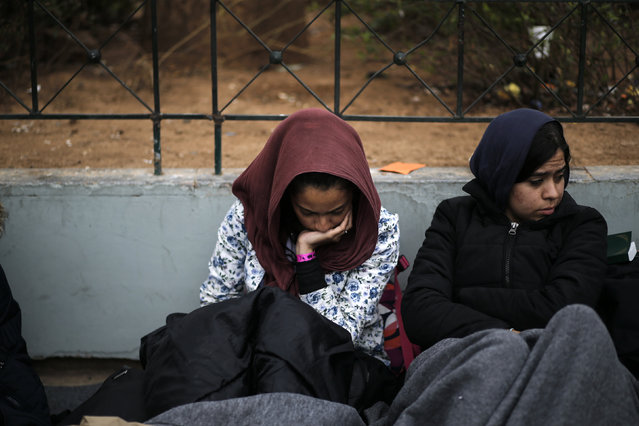 Stranded Afghan migrants rest on Victoria square in Athens, Greece, February 24, 2016. (Photo by Alkis Konstantinidis/Reuters)