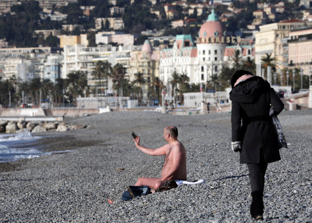 A man in swimsuit takes a selfie on the beach of the Promenade des Anglais during a cold and sunny winter's day in Nice, France, January 17, 2017. (Photo by Eric Gaillard/Reuters)