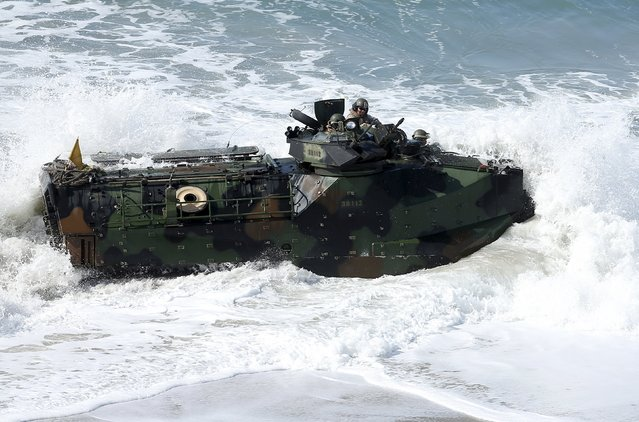 Soldiers from Japan's Ground Self-Defense Force, with the help of a U.S. Marine, drive a Amphibious Assault Vehicle ashore as they train alongside U.S. Marines during the bilateral annual Iron Fist military training exercise in Camp Pendleton, California February 26, 2016. (Photo by Mike Blake/Reuters)