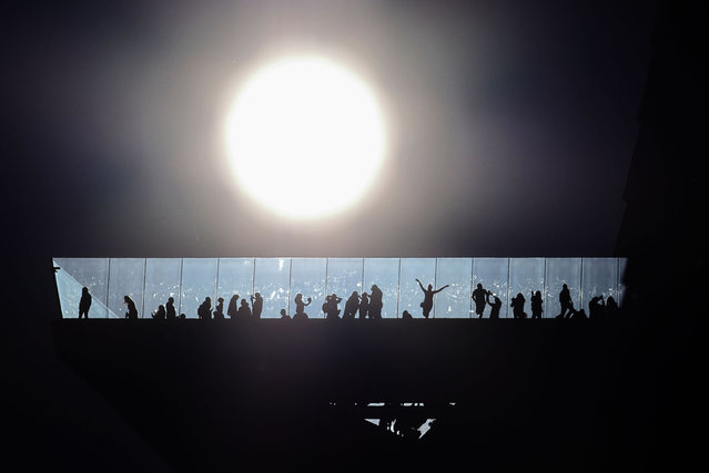 The sun passes behind the EdgeNYC observation deck at Hudson Yards on July 31, 2021 in New York City.  (Photo by Gary Hershorn/Getty Images)