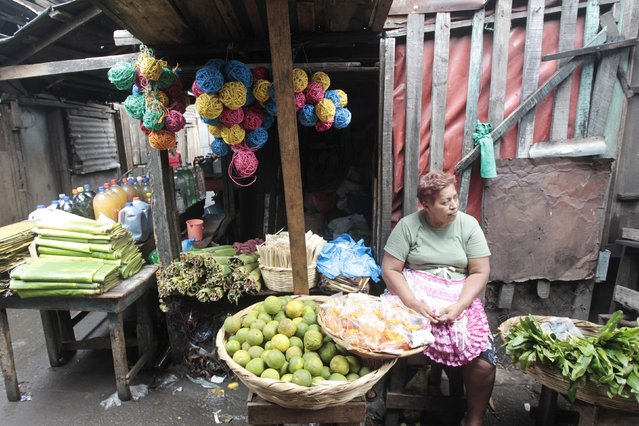 A woman sells fruit at the Oriental market, considered one of Central America's largest market, in Managua April 30, 2015, a day before International Worker's Day. International Workers' Day, also known as Labour Day or May Day, commemorates the struggle of workers in industrialised countries in the 19th century for better working conditions. (Photo by Oswaldo Rivas/Reuters)