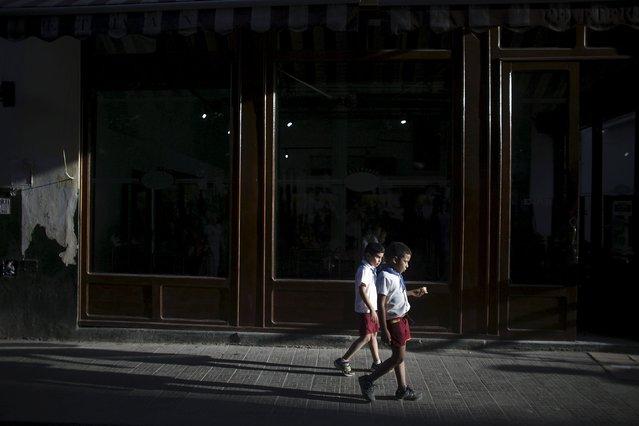 Boys walk in downtown Havana, Cuba March 8, 2016. (Photo by Alexandre Meneghini/Reuters)