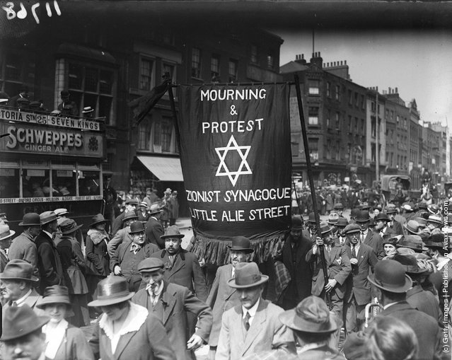 26th June 1919:  Jewish men in Whitechapel, east London, march in protest against the killing of Jews in Poland