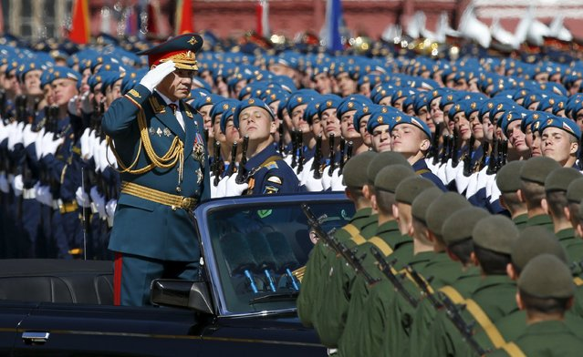 Russian Defence Minister Sergei Shoigu salutes during a rehearsal for the Victory Day parade in Red Square in central Moscow, Russia, May 7, 2015. (Photo by Sergei Karpukhin/Reuters)