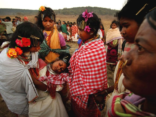 A member of Dongria tribe girl faints after dancing in trance during the two-day long Niyamraja Festival atop of the Niyamgiri hills near Lanjigarh in Kalahandi district, Orissa state. (Photo by Biswaranjan Rout/AP Photo)
