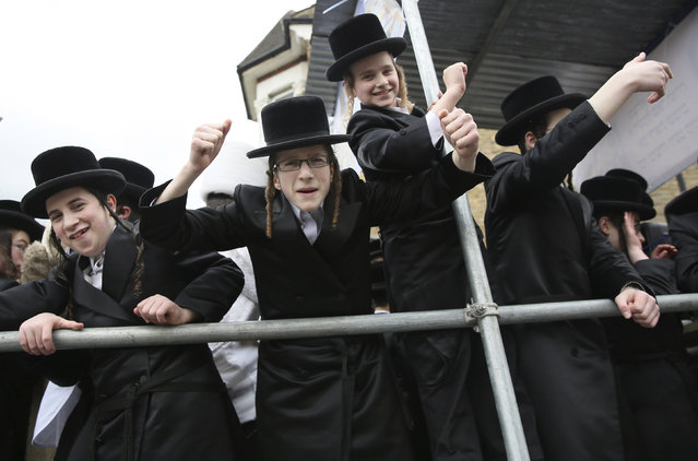 Members of the Jewish community dance on the back of a lorry as they celebrate the festival of Purim in Stamford Hill in north London, Britain March 24, 2016. (Photo by Neil Hall/Reuters)