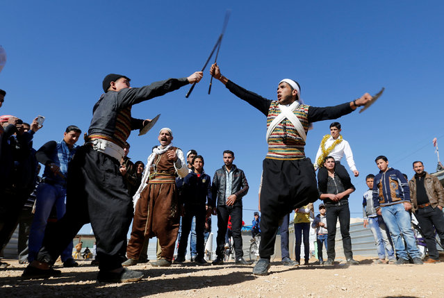 The Syrian refugee folklore troupe Abu Rustom perform at a wedding show at Zaatari refugee camp in the Jordanian city of Mafraq, near the border with Syria February 20, 2017. (Photo by Muhammad Hamed/Reuters)