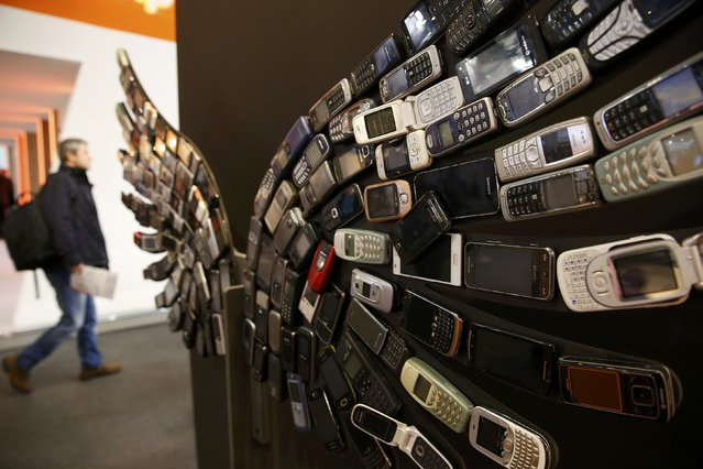 Old mobile phones are seen as part of an artwork on display at the Aptoide stand at the Mobile World Congress in Barcelona, Spain, February 28, 2017. (Photo by Paul Hanna/Reuters)