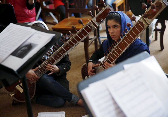 Members of the Zohra orchestra, an ensemble of 35 women, attend a rehearsal at Afghanistan's National Institute of Music, in Kabul, Afghanistan April 4, 2016. (Photo by Ahmad Masood/Reuters)
