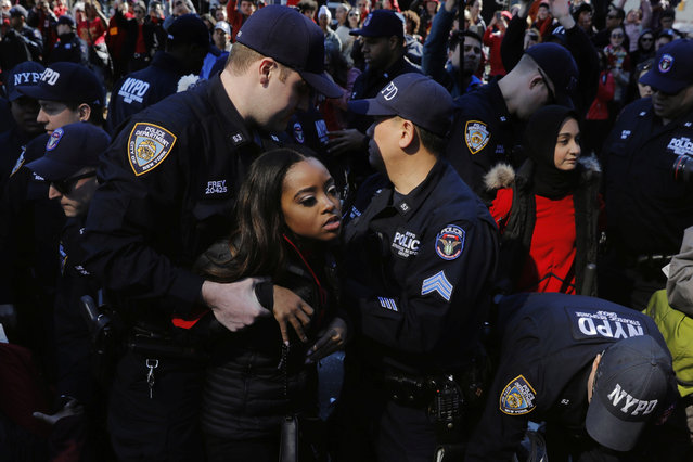"New York Police Department officers detain organizer Tamika Mallory as she takes part in a ""Day Without a Woman"" march on International Women's Day in New York, March 8, 2017. (Photo by Lucas Jackson/Reuters)"