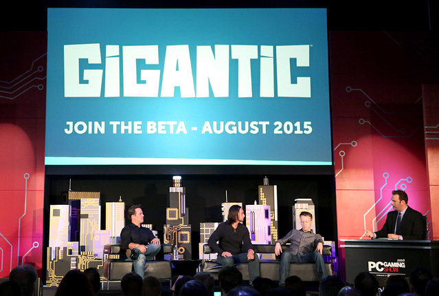From left, Phil Spencer, Head of Xbox, James Phinney, Creative Director, Motiga, and David Eckelberry, Game Director, Lionhead Studios, share more information on free-to-play MOBA shooter Gigantic for Windows 10 onstage at the Xbox-sponsored PC Gaming Show in Los Angeles on Tuesday, June 16, 2015. (Photo by Casey Rodgers/Invision for Microsoft/AP Images)