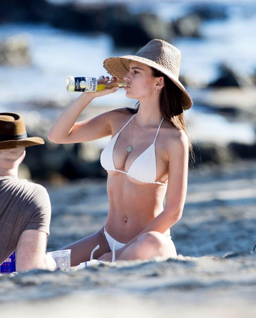 Emily Ratajkowski sun bathes at Paradise Cove in Malibu, CA on March 9, 2017. (Photo by Splash News and Pictures)