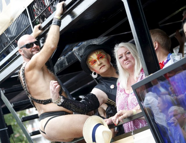 People participate in on a truck at the annual Christopher Street Day parade on Kurfuerstendamm in Berlin, Germany, June 27, 2015. (Photo by Fabrizio Bensch/Reuters)