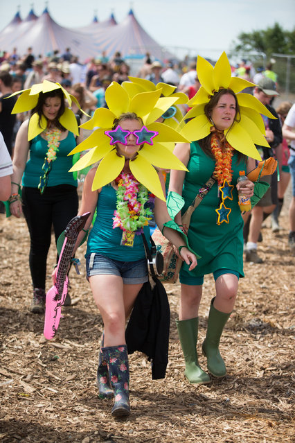 Festival goers in fancy dress attend the Glastonbury Music Festival on Saturday, June 27, 2015 at Worthy Farm, Glastonbury, England. (Photo by Jim Ross/Invision/AP Photo)