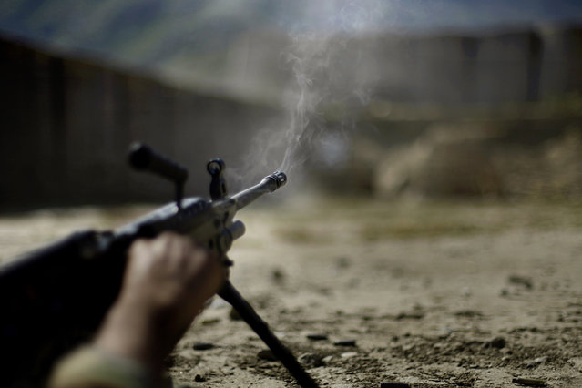 Afghan National Army soldiers train on a firing range at a U.S. army base in the Pech Valley of Afghanistan's Kunar province Sunday, November 1, 2009. (Photo by David Guttenfelder/AP Photo)