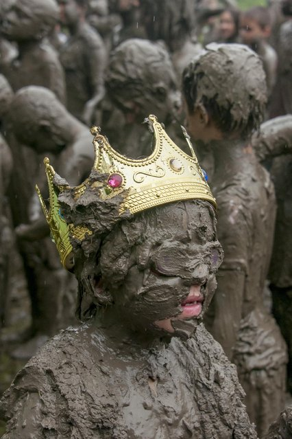 Six-year-old Emileigh Powers, of Troy, New York, was named Mud Queen at the annual Mud Day in Nankin Mills Park in Westland, Mich. on Tuesday, July 7, 2015. (Photo by David Guralnick/The Detroit News via AP Photo)
